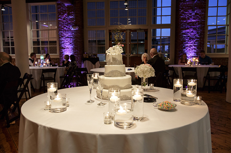 Kansas city wedding kyle sarah click photography love the accent lightingdefinitely helps to showcase such a stunning wedding cake by icing on the cake junglespirit Image collections